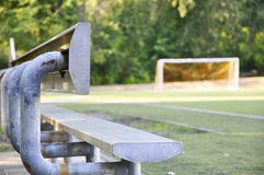 Bleacher seats with soccer field and net. Royalty Free Stock Images