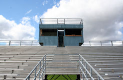 Bleachers. Aluminum bleachers near a football field stock images