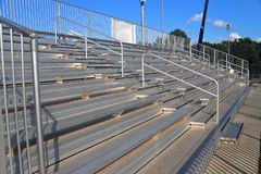 Bleachers in little league baseball field. Clean Stadium bleachers in outdoors for watching sporting events stock images