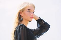 Bleaching roots. Salvaged my bleached hair. How to take care of bleached hair. Girl tender blonde makeup face sky. Background. How to repair bleached hair fast royalty free stock image