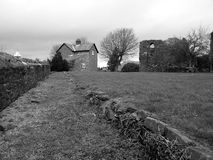 Bleak monotone welsh landscape with castle Stock Photo