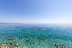 Blear blue waters on the island of Samos, Greece Royalty Free Stock Image