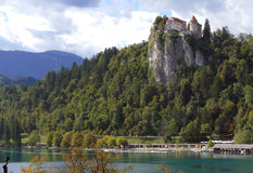 Bled Castle built on top of a cliff overlooking lake Bled, locat Royalty Free Stock Images