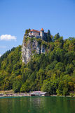Bled castle. Photo of scenic bled lake with medieval castle on the top of rock Stock Photo