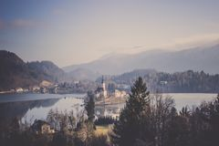 Bled castle on small island surrounded by lake hills forest Stock Image