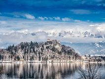 The Bled Castle and St Mary Church on Bled island, Slovenia. The Bled Lake with the view of the Bled Castle and Church of the Asumption of Maria on Bled island Royalty Free Stock Photos