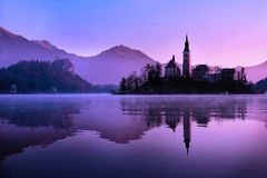 Bled Church, Slovenia. The church of Assumption reflection during sunset, Bled, Slovenia Stock Image