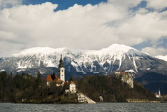 Bled Lake. And church, snow and mountains in the background in a sunny day - Slovenia 2009 Royalty Free Stock Photos