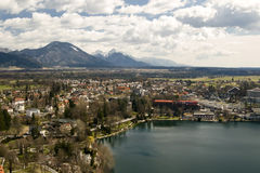 Bled Lake. And town with mountain in the background in a sunny day with clouds - Slovenia 2009 royalty free stock image