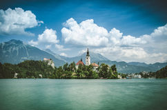 Bled lake with medieval castle Blejski grad, Slovenia. Summer scene in the park of Bled lake with medieval castle Blejski grad, Slovenia Royalty Free Stock Photo