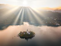 Bled Lake with Pilgrimage Church of the Assumption of Maria at sunrise. royalty free stock images