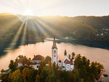 Bled Lake with Pilgrimage Church of the Assumption of Maria at sunrise. stock image