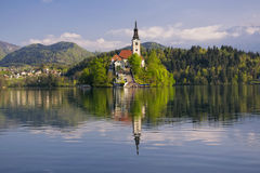 Bled lake and pilgrimage church with mountain landscape background Royalty Free Stock Photos