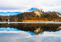 Bled Lake, Reflection of autumn. Lake Bled in Autumn, reflection of the castle on the hill in the water, Slovenia Stock Photography
