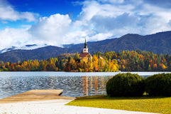 Bled Lake, Slovenia, Europe. Amazing View On Bled Lake. Autumn in Slovenia, Europe. View on Island with Catholic Church in Bled Lake with Autumn Forest and Royalty Free Stock Image