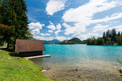 Bled lake, Slovenia. Pure blue water and swimming peoples in the lake, near church on the island on middle of the lake stock images
