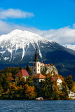 Bled lake with snow on the mountains in autumn Royalty Free Stock Photo
