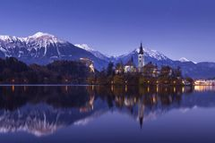 Bled lake at winter night with stars and reflection royalty free stock photo