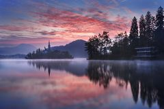 Bled in Slovenia, Europe. Amazing View for sunrise : Bled Lake, Island,Church And Castle With Mountain Range Stol, Vrtaca, Begunjscica In The Background-Bled royalty free stock photography