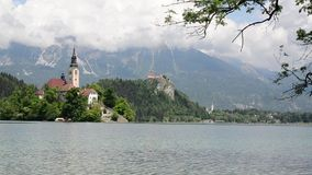 Bled in spring, popular tourist and travel destination. Beautiful Lake Bled in the Julian Alps, Slovenia, Upper Carniolan. View ov. Er Lake Bled. Island, castle stock video