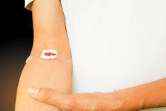 Bleeding cotton bandage from blood check up wound royalty free stock images