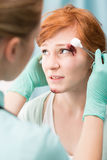 Bleeding cut above eye Stock Image