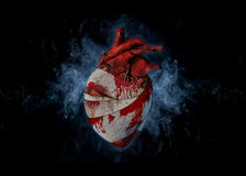 Bleeding heart. Symbolic illustration of a broken heart covered with bloodstained bandages Royalty Free Stock Photo