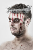 Bleeding man with crown of barbed wire Stock Photos