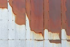 Bleeding rust background. Bleeding metal exterior, abstract background Royalty Free Stock Photo