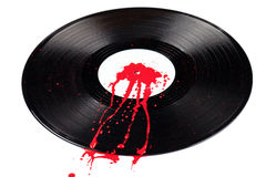 Bleeding Vinyl. A 12 inch vinyl record with blood spatter on it isolated on white Stock Images