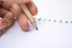 Bleistift auf einem Buch Lizenzfreies Stockfoto