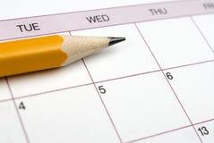 Bleistift auf einem Kalender. Stockbild