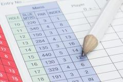 Bleistift auf einer Golfspielstandskarte Stockfoto