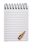 Bleistift auf Notizblock Stockfotos