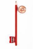 Bleistift, Bleistiftspitzer und rotes Rasieren Lizenzfreies Stockbild