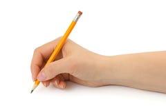 Bleistift in der Frauenhand Stockbild
