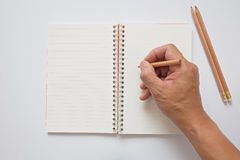 Bleistift in der Hand und Anmerkungsbuch Lizenzfreies Stockbild