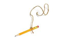 Bleistift gebunden mit Zeichenkette Lizenzfreies Stockbild