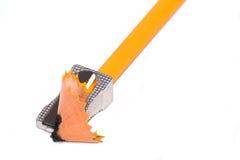 Bleistift mit Bleistiftspitzer Stockbild