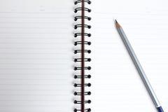 Bleistift mit Buch Lizenzfreie Stockfotografie