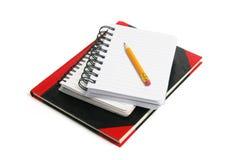 Bleistift und Anmerkungs-Bücher Stockbilder