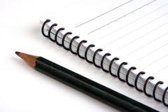 Bleistift und Anmerkungsbuch Stockfoto