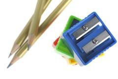 Bleistift und Bleistiftspitzer Stockbilder