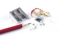 Bleistift und Bleistiftspitzer Stockfotos