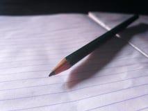 Bleistift und Buch Stockfotos