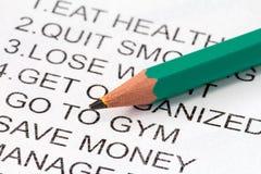 Bleistift und Liste von Beschlüsse Lizenzfreie Stockfotos