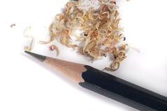 Bleistift und Schnitzel Stockfotografie