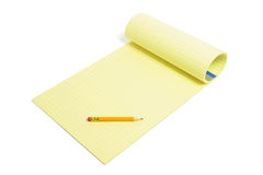 Bleistift und Schreibens-Auflage Lizenzfreie Stockbilder
