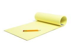 Bleistift und Schreibens-Auflage Lizenzfreies Stockfoto