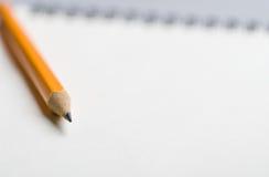 Bleistift an während Hintergrund Lizenzfreie Stockfotografie